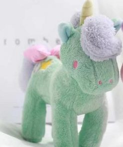 stuffed animal unicorn standing green and pink