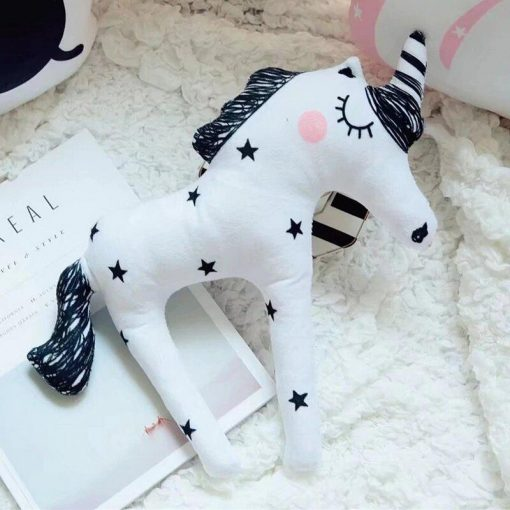 White unicorn stuffed animal draw